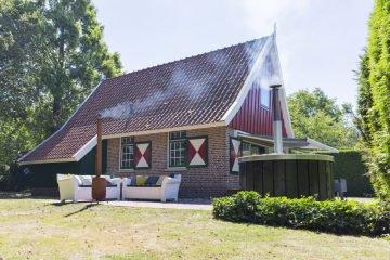 Vakantiehuis met hot tub en brandende buiten haard
