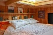 Close up van het tweepersoons bed in het tiny house op de Veluwe