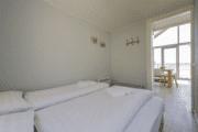 Slaapkamer van strandhuisje in Julianadorp